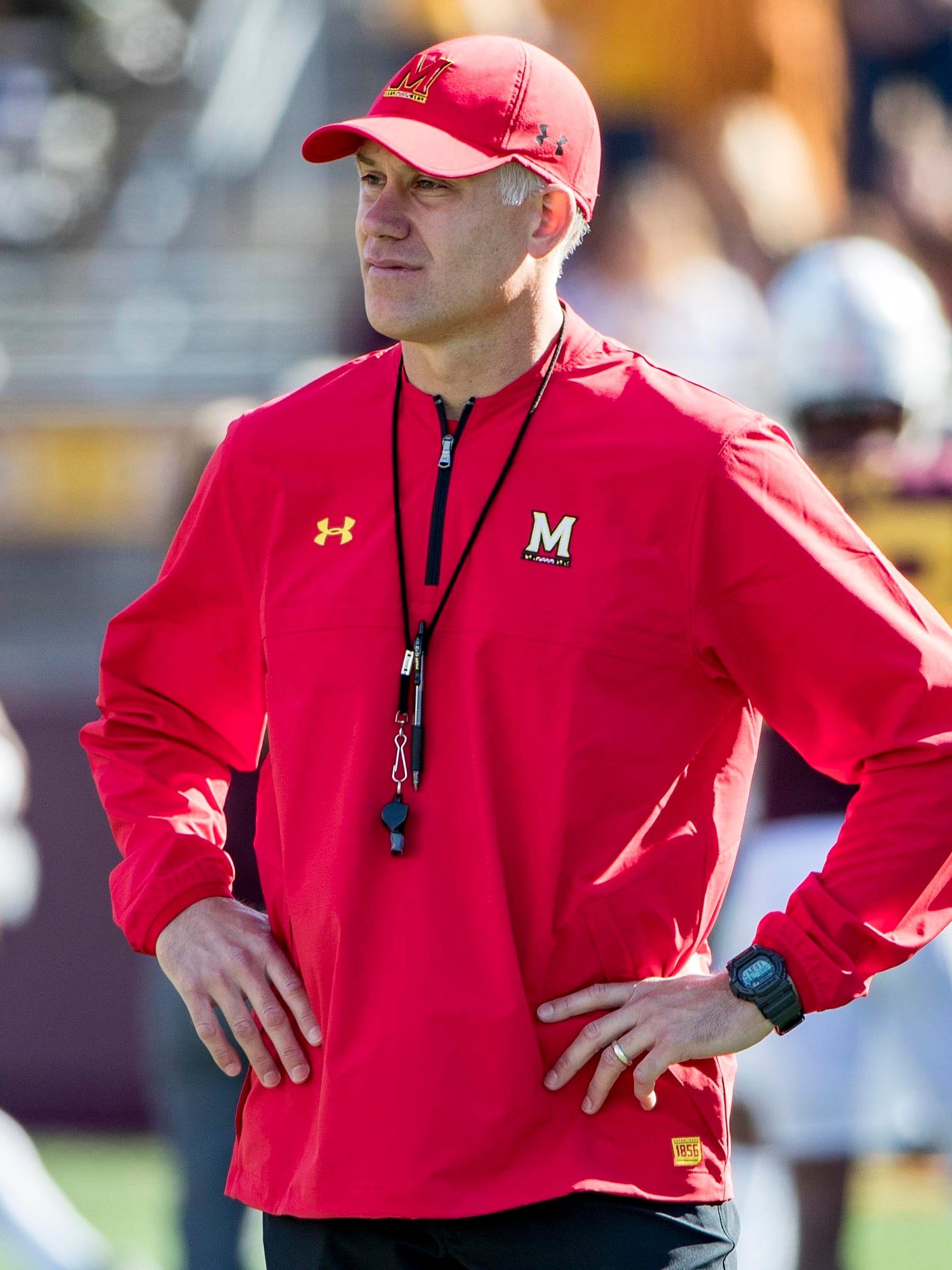 Maryland coach DJ Durkin stands on the sideline before his team's game against Minnesota.