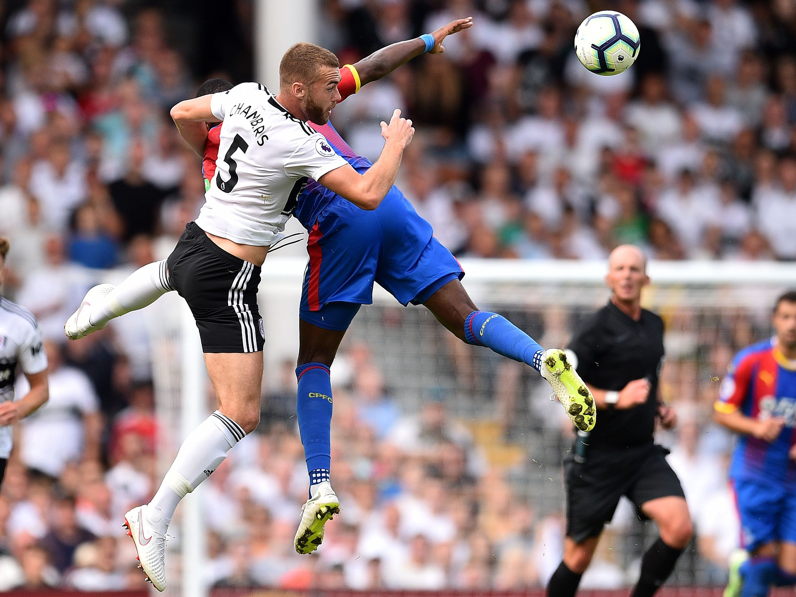 Fulham defender Calum Chambers vies for the ball with Crystal Palace striker Christian Benteke.