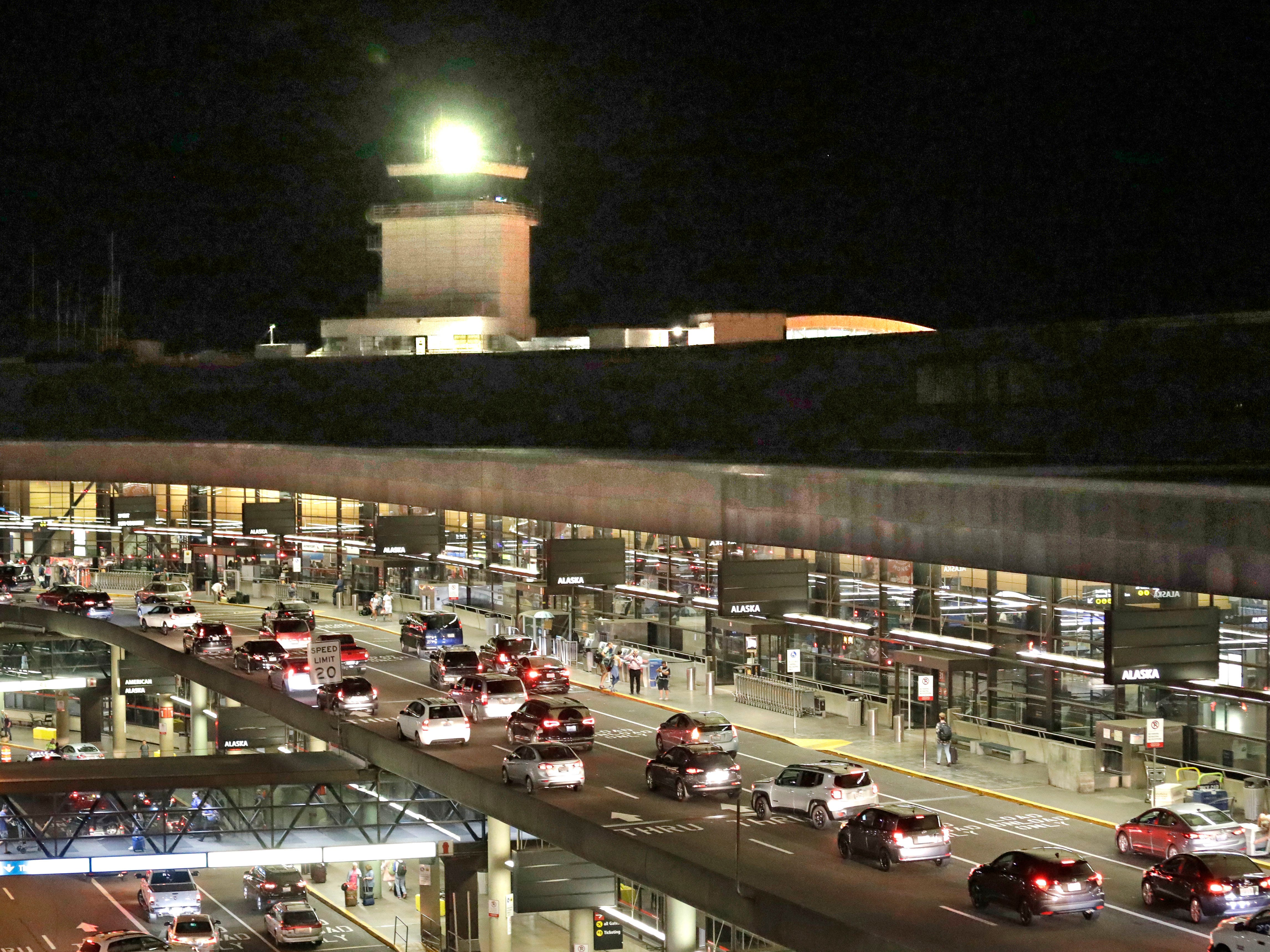 Traffic arrives at Sea-Tac International Airport terminal Friday evening, Aug. 10, 2018, in SeaTac, Wash. An airline mechanic stole an Alaska Airlines plane without any passengers and took off from Sea-Tac International Airport in Washington state on Friday night before crashing near Ketron Island, officials said.(AP Photo/Elaine Thompson) ORG XMIT: WAET107