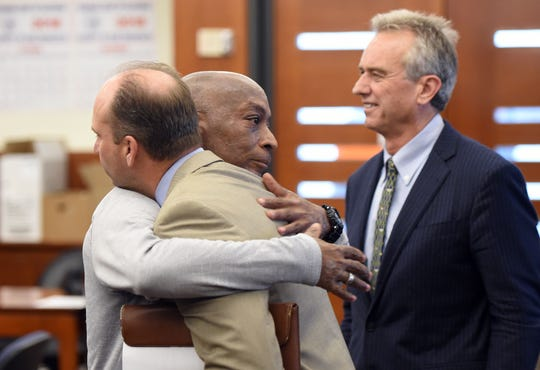 Dewayne Johnson hugs one of his attorneys after the verdict was read in the case against Monsanto at the Superior Court Of California in San Francisco. Robert F. Kennedy Jr. a member of Johnson's legal team is seen at right.