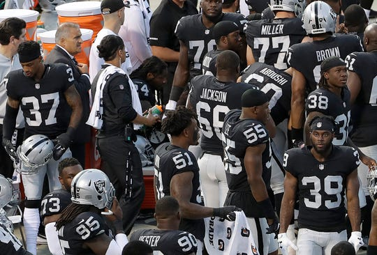 Marshawn Lynch (24) sits near the sideline just before the national anthem.