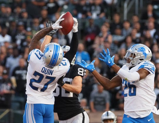 Detroit Lions defensive back Glover Quin (27) breaks up a pass intended for Oakland Raiders wide receiver Jordy Nelson (82) during the first quarter at Oakland Coliseum.