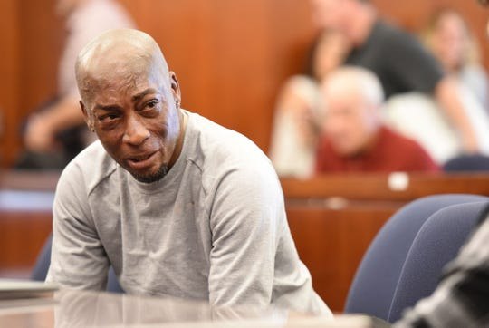 Plaintiff Dewayne Johnson reacts after hearing the verdict to his case against Monsanto at the Superior Court Of California in San Francisco, on Aug. 10, 2018.  The jury ordered agrochemical giant Monsanto to pay nearly $290 million for failing to warn the dying groundskeeper that its weed killer Roundup might cause cancer.