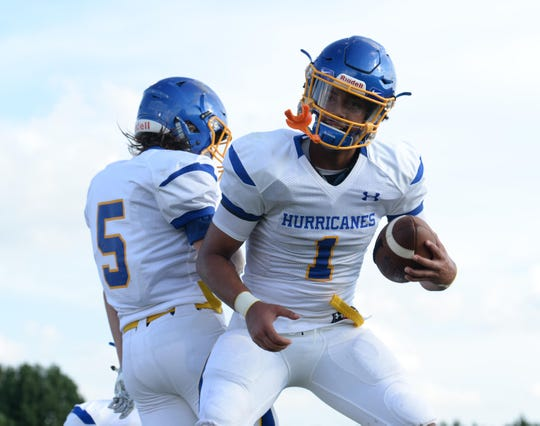 Wren senior quarterback Tyrell Jackson, right, celebrates with Wren sophomore Briggs Cox after scoring against Pendleton during the first game of the 2018 Anderson County FCA Jamboree at Belton-Honea Path High School in Honea Path on Friday, August 10.