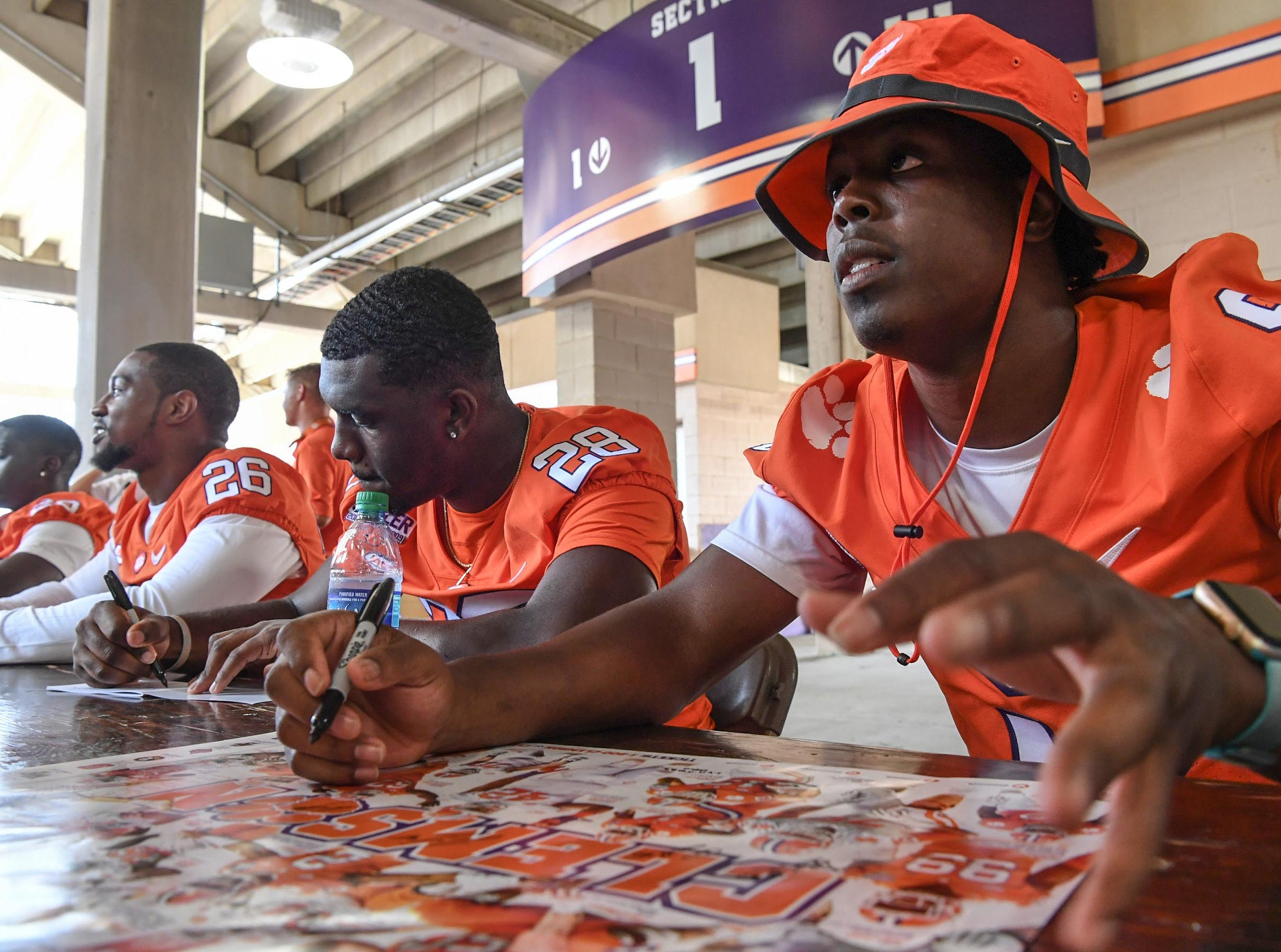 Clemson running back Tavien Feaster (28), left, and Travis Etienne (9), right, during Clemson University football fan day in Memorial Stadium on Sunday, August 12, 2018.