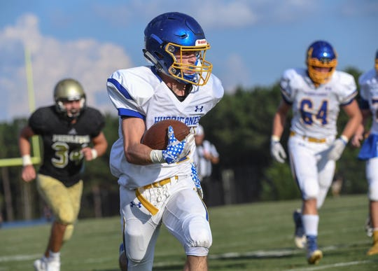 Wren senior Luke Bryant runs by Pendleton defenders for a touchdown during the first game of the 2018 Anderson County FCA Jamboree at Belton-Honea Path High School in Honea Path on Friday, August 10.