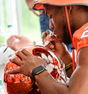 Clemson quarterback Kelly Bryant (2) signs autographs during Clemson University football fan day in Memorial Stadium on Sunday, August 12, 2018.