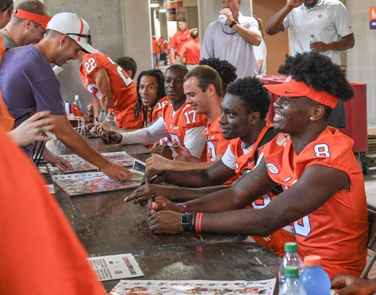 Clemson wide receiver Justyn Ross (8), right, and wide receivers during Clemson University football fan day in Memorial Stadium on Sunday, August 12, 2018.