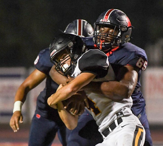 Belton Honea Path senior Tysheik Galloway tackles Crescent senior Murphy McBride  during the fourth game of the 2018 Anderson County FCA Jamboree at Belton-Honea Path High School in Honea Path on Friday, August 10.