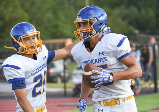 Wren junior Tyler Cherry, right, is congratulated by teammate Wren junior Noah Black, left, after scoring against Pendleton during the first game of the 2018 Anderson County FCA Jamboree at Belton-Honea Path High School in Honea Path on Friday, August 10.