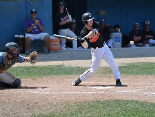 Jeremy Quade of the Lombard Orioles takes a swing during the championship game Sunday of the NABF World Series in Battle Creek.