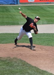 Gunar Kay of Lombard throws home during the championship game of the NABF World Series in Battle Creek on Sunday.