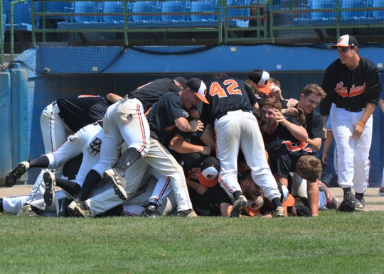 The Lombard Orioles celebrate after getting the last out as they won the 105th NABF World Series at C.O. Brown Stadium in Battle Creek.