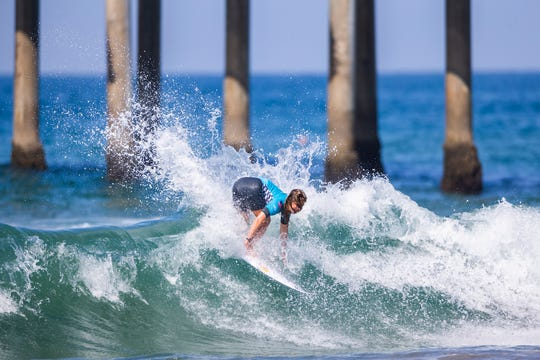Caroline Marks (USA) advances to the Quarterfinals of the 2018 Women's VANS US Open of Surfing after placing second in Heat 4 of Round 3 at Huntington Beach, CA, USA.