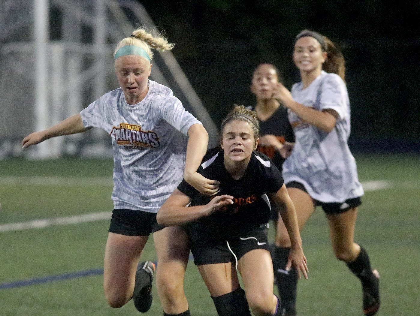 Ryle's  Kylee  Fountain (14) battles a Turpin player against during Soccerama, Saturday, Aug. 11,2018.