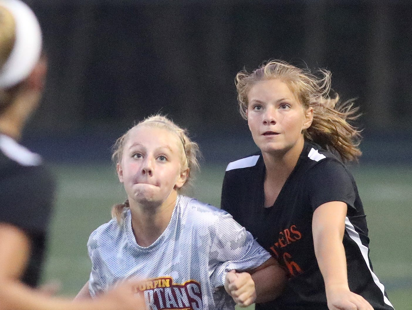 Ryle's Sarah Lonneman (16) battles a Turpin player for the  ball during  Soccerama, Saturday, Aug. 11,2018.