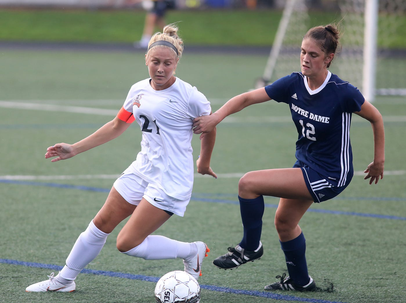 NDA's Maya Decker (12) battles  Anderson's Emily Camden for the ball during Soccerama at Tower Park, Saturday, Aug. 11, 2018.