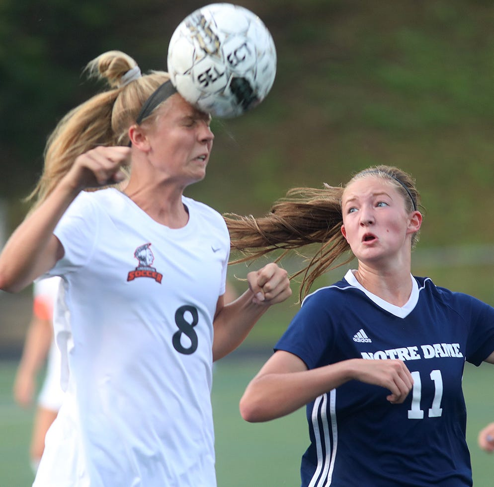 Anderson's  Karley Steinher (8)  heads the ball during Soccerama against Notre Dame Academy's Julia Day at Tower Park, Saturday, Aug. 11, 2018.