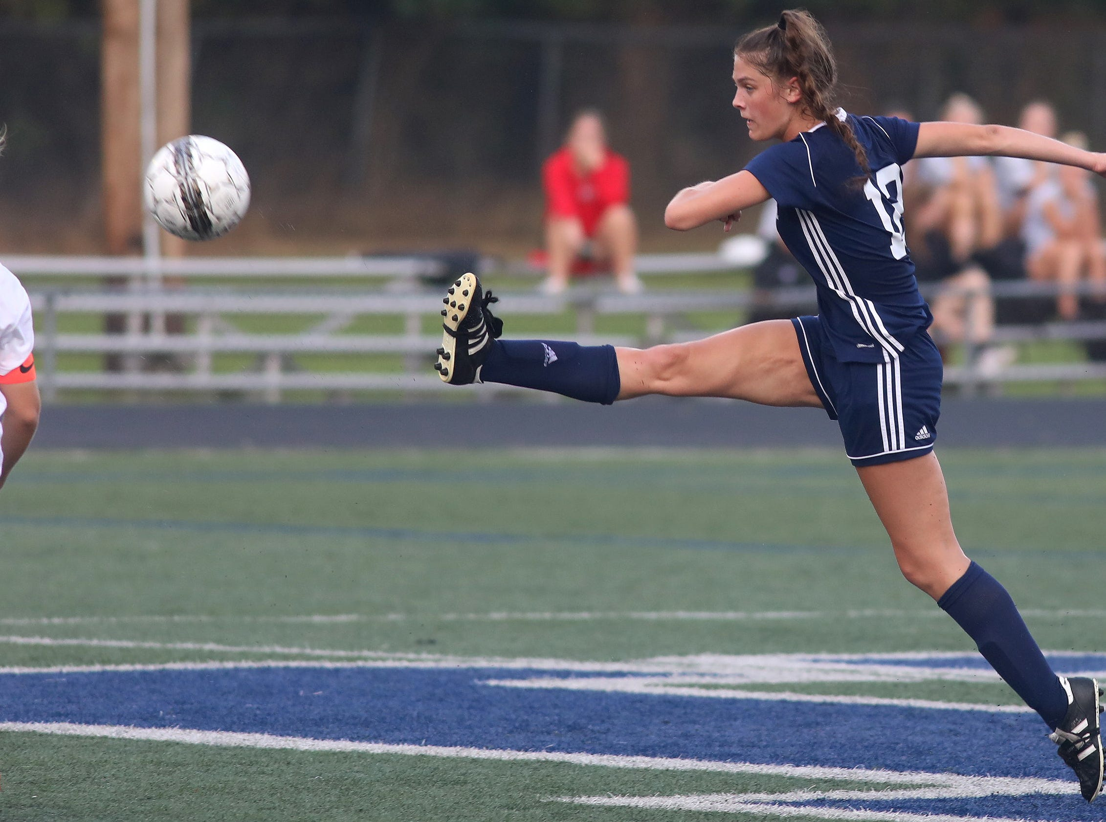 Notre Dame Academy's Maya Decker kicks the ball during Soccerama  against Anderson at Tower Park, Saturday, Aug. 11,2018.