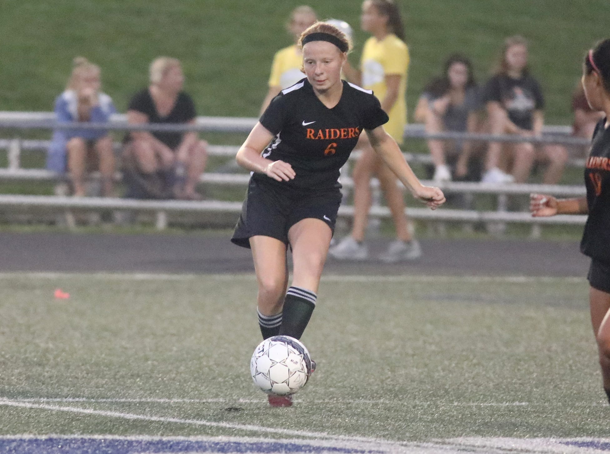 Ryle's  Kaia  Griffin  (6) kicks in the game against Turpin during Soccerama, Saturday, Aug. 11, 2018.