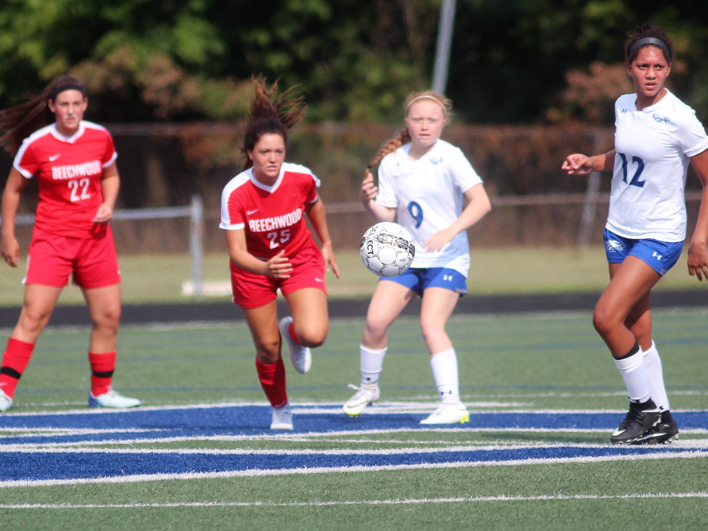 Players from both teams eye the ball as Beechwood plays Scott in girls Soccerama scrimmage Aug. 10, 2018 at Tower Park, Fort Thomas.