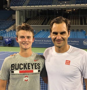 J.J. Wolf and tennis legend Roger Federer pose for a photograph following a hitting session at the Lindner Family Tennis Center.
