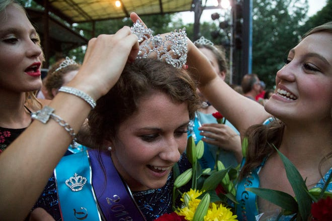 Two other county fair queens help 2018 Iowa State Fair Queen Hailey Swan, of Davis County, adjust her crown on Saturday, August 11, 2018, during the annual queen coronation ceremony in Des Moines.