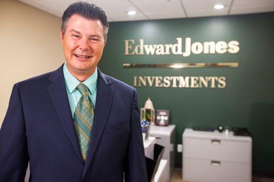 Robert Milbrath, Edward Jones financial adviser, stands for a portrait Aug. 8 at an Edward Jones branch office in Cedar Rapids.
