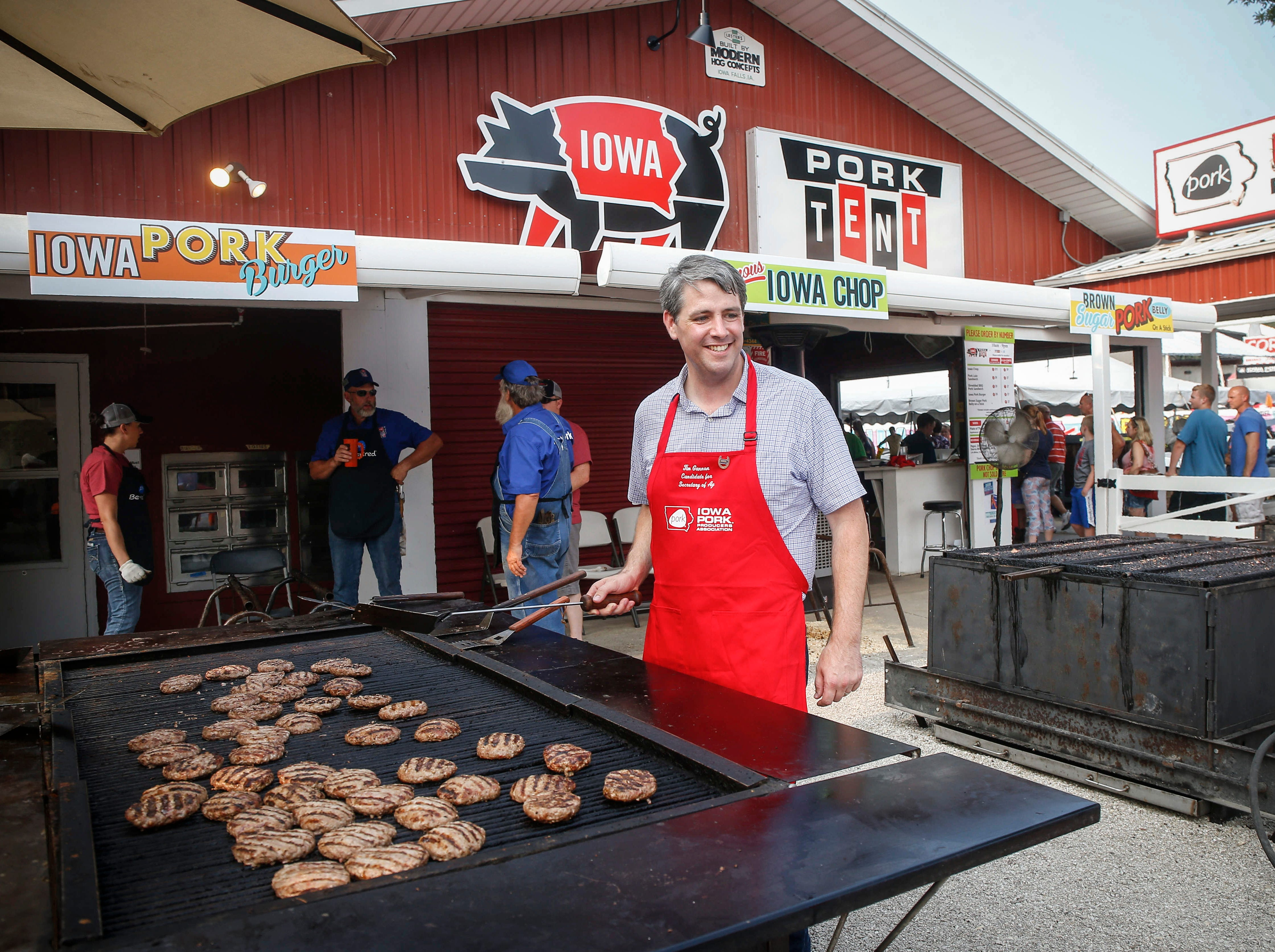 Tim Gannon, Democratic candidate for Iowa Secretary of Agriculture, stopped by to flip pork burgers at the Iowa Pork Tent on Saturday, Aug. 11, 2018, during the Iowa State Fair in Des Moines.