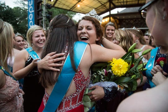 2018 Iowa State Fair Queen Hailey Swan, of Davis County, is embraced by other county fair queens after receiving her crown on Saturday, August 11, 2018, during the annual queen coronation ceremony in Des Moines.
