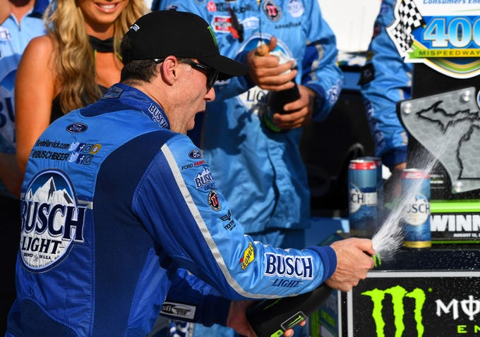 Kevin Harvick (4) reacts after winning the Consumers Energy 400 at Michigan International Speedway.