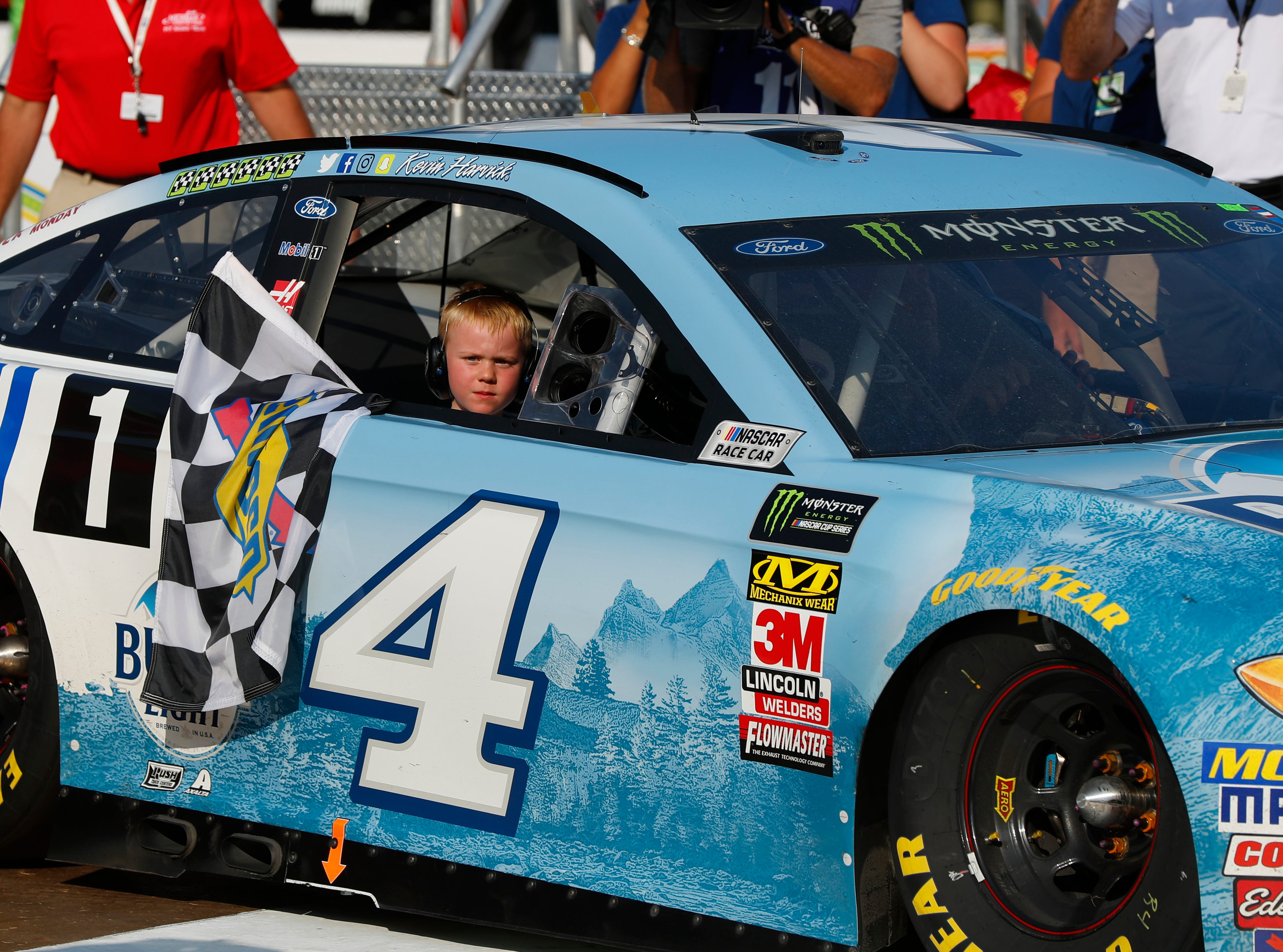 Kevin Harvick's son, Keelan, rides into Winner's Circle with his father after a NASCAR Cup Series auto race at Michigan International Speedway in Brooklyn, Mich., Sunday, Aug. 12, 2018.