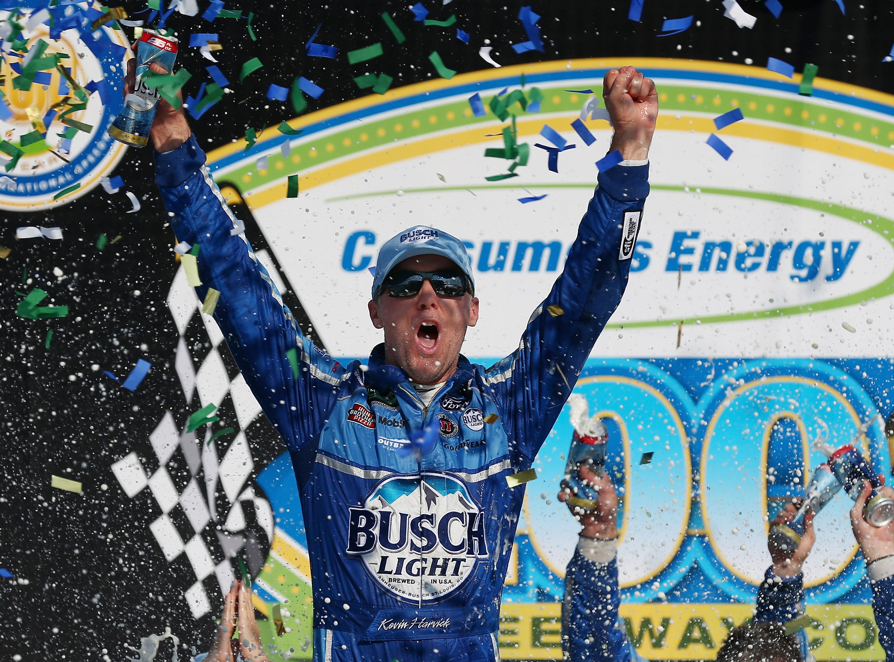 Kevin Harvick, driver of the No. 4 Busch Light/Mobil 1 Ford, celebrates in Victory Lane after winning the Monster Energy NASCAR Cup Series Consumers Energy 400 at Michigan International Speedway on August 12, 2018 in Brooklyn, Michigan.