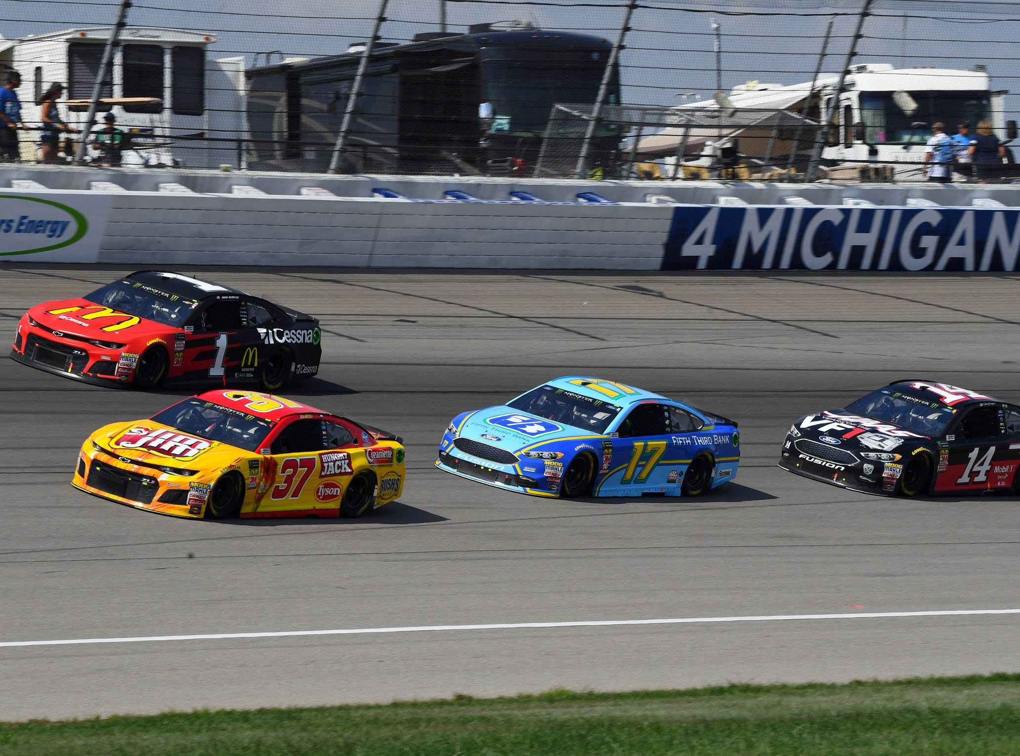 Chris Buescher (37), Jamie Mcmurray (1), Ricky Stenhouse Jr. (17), and Clint Bowyer (14) race during the Consumers Energy 400 at Michigan International Speedway.