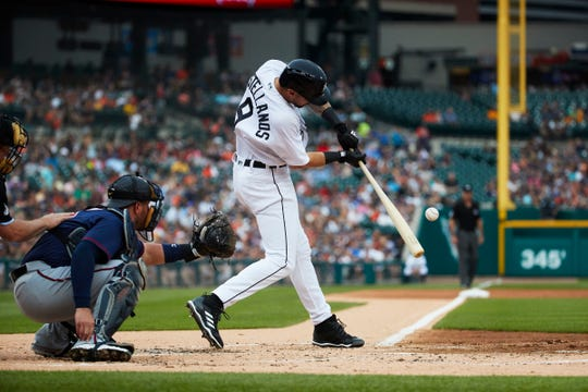 Detroit Tigers right fielder Nicholas Castellanos (9) hits a single in the first inning against the Minnesota Twins at Comerica Park on Aug. 11, 2018.