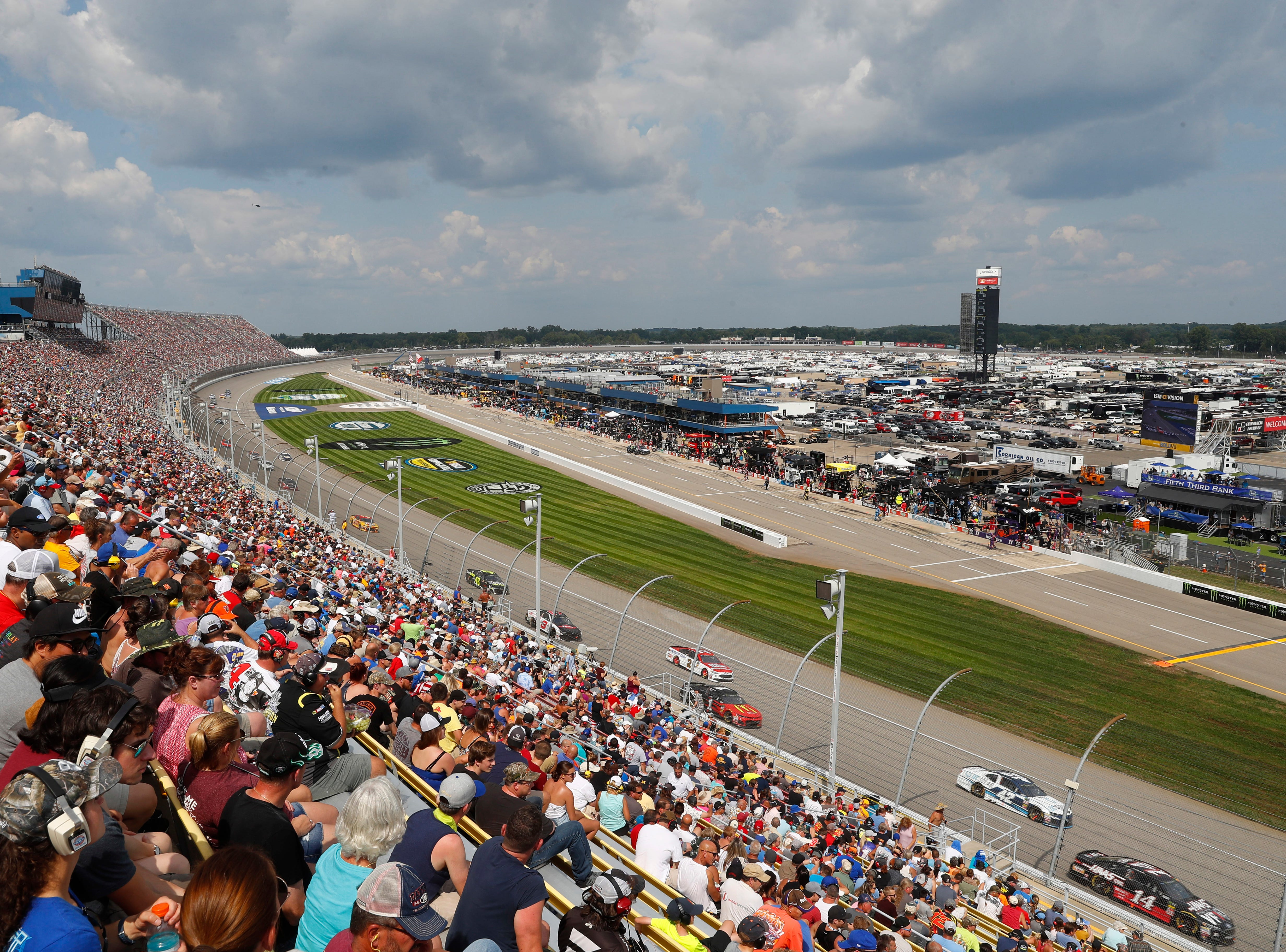 Fans watch a NASCAR Cup Series auto race at Michigan International Speedway in Brooklyn, Mich., Sunday, Aug. 12, 2018.