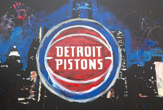 Speed finger painter, Jarred Emerson, unveils the new Detroit Pistons logo on Tuesday, May 16, 2017 at Campus Martius Park in Detroit.