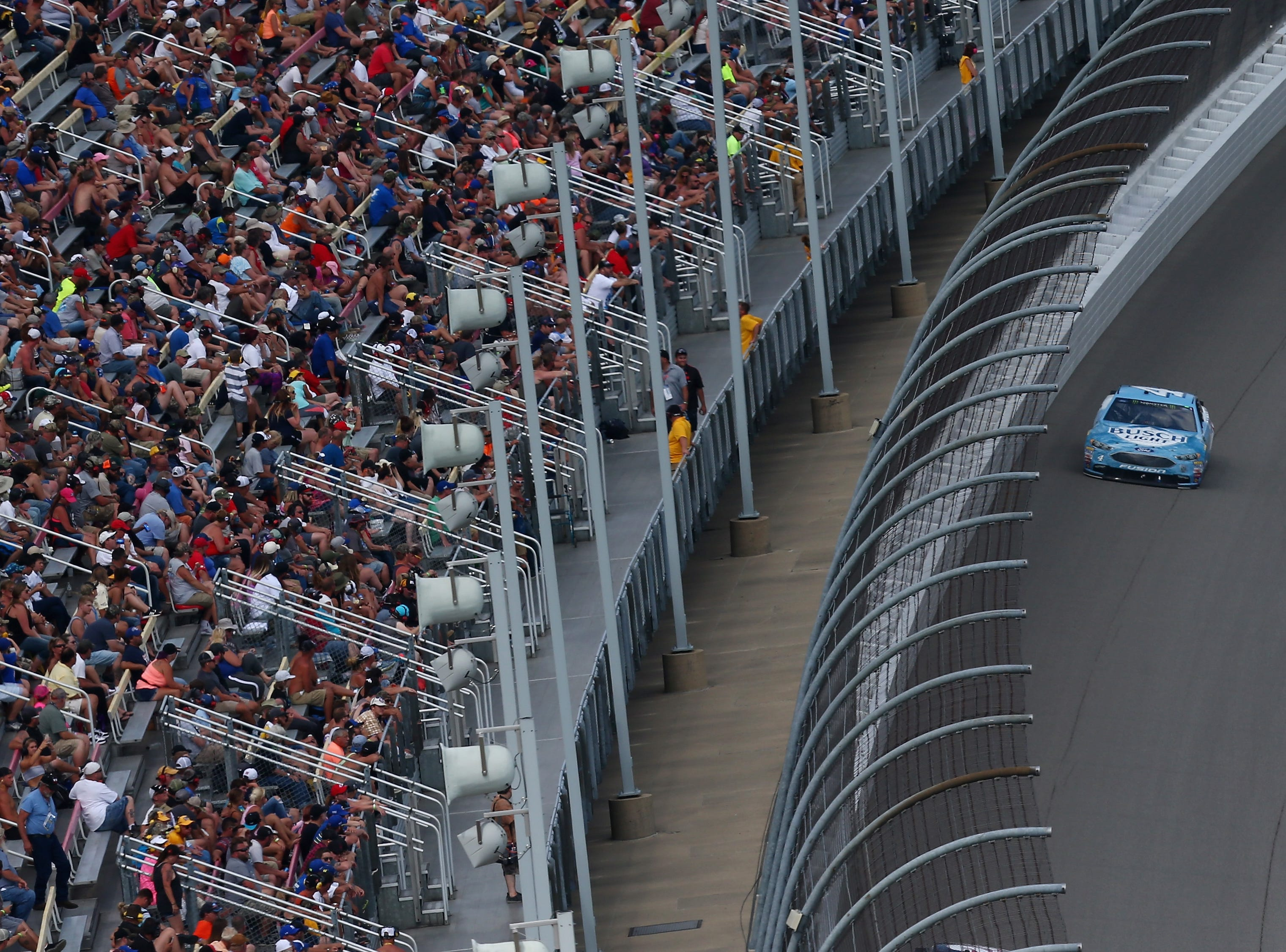 Kevin Harvick, driver of the No. 4 Busch Light/Mobil 1 Ford, races during the Monster Energy NASCAR Cup Series Consmers Energy 400 at Michigan International Speedway on August 12, 2018 in Brooklyn, Michigan.