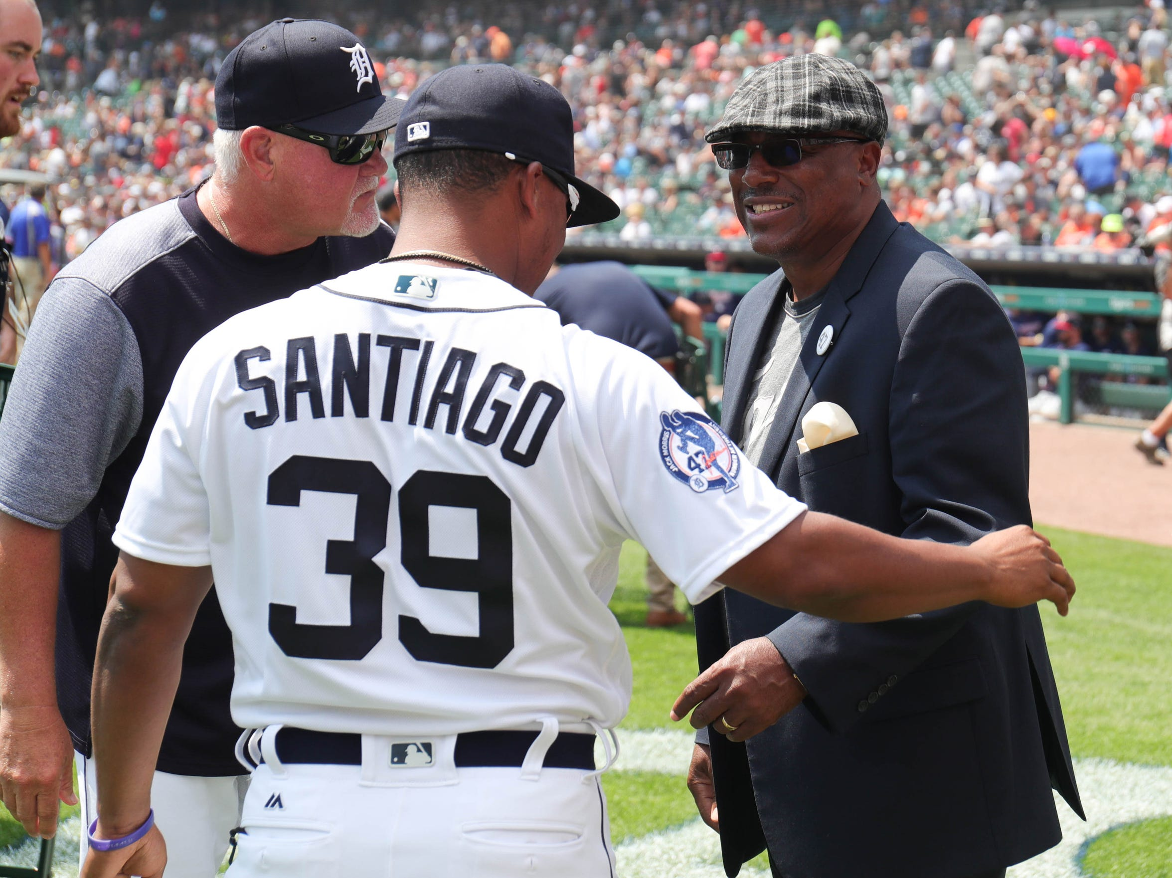 Tigers manager Ron Gardenhire, left, former shortstop Lou Whitaker and Tiger Ramone Santaigo talk before the start of the Tigers game against Minnesota on Sunday, August 12, 2018, at Comerica Park in Detroit.