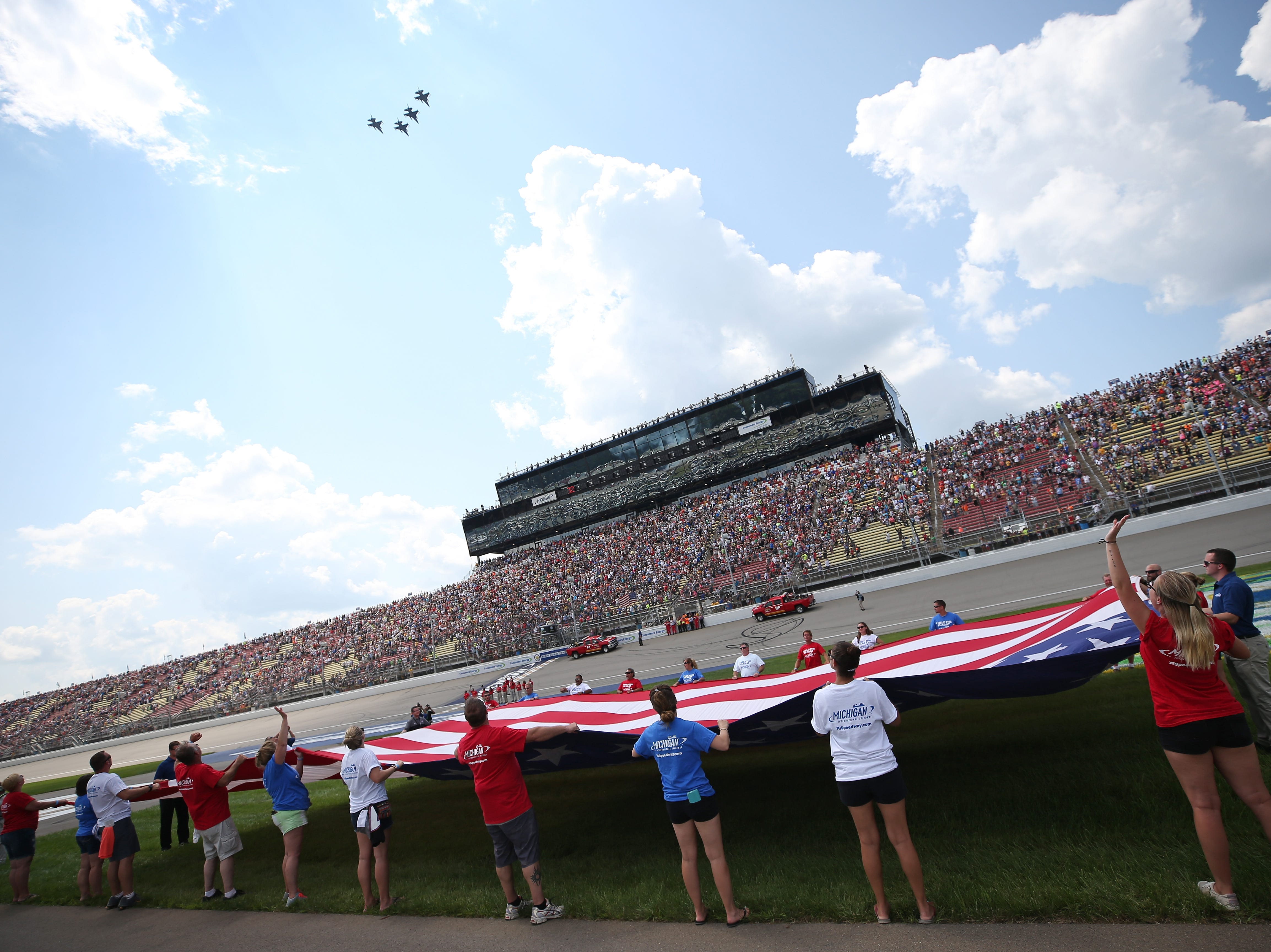 A flyover is performed during the national anthem prior to the start of the Monster Energy NASCAR Cup Series Consmers Energy 400 at Michigan International Speedway on August 12, 2018 in Brooklyn, Michigan.