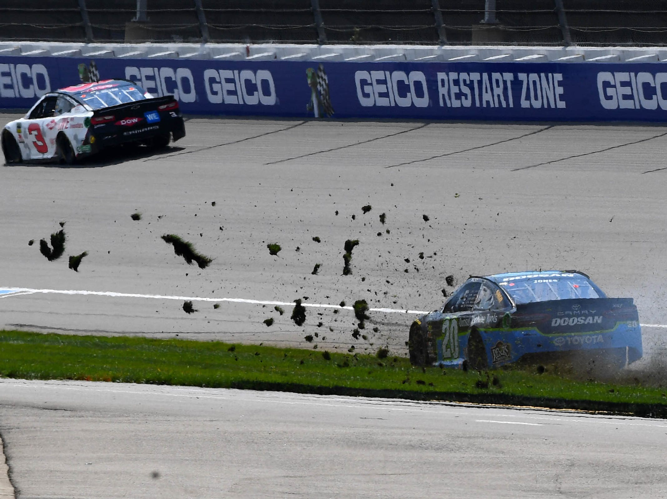 Erik Jones (20) spins in turn four during the Consumers Energy 400 at Michigan International Speedway.