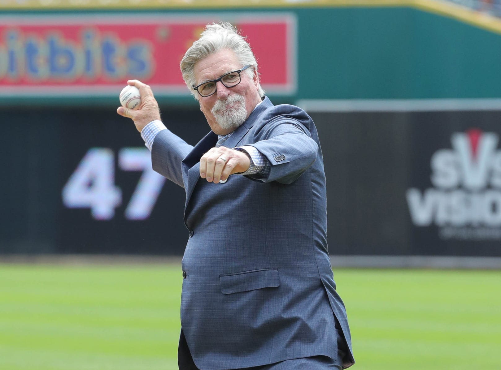 Detroit Tigers Hall of Fame pitcher Jack Morris throws a ceremonial pitch to teammate Lance Parrish before the start of the Tigers game against Minnesota on Sunday, August 12, 2018, at Comerica Park in Detroit.