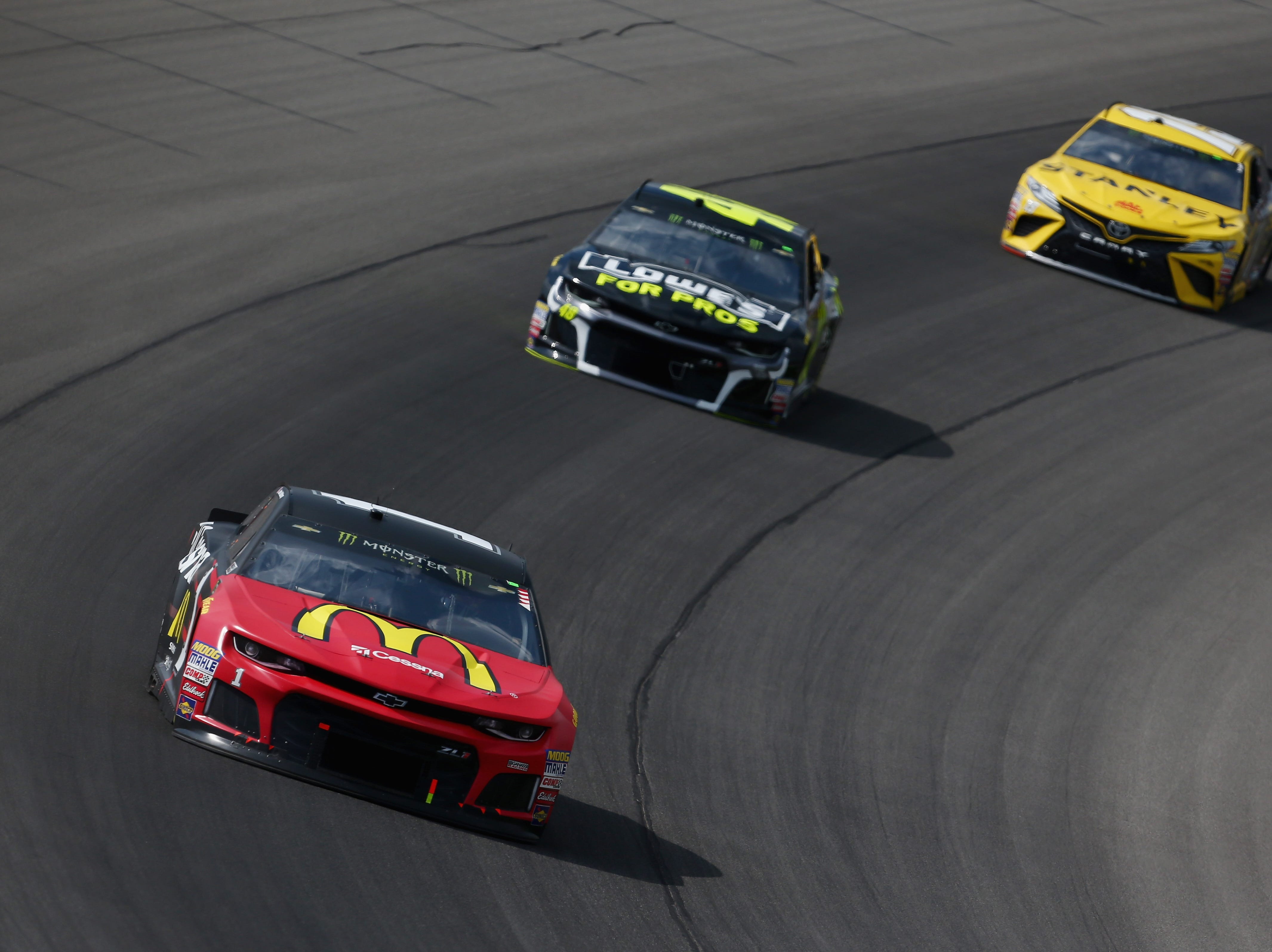 Jamie McMurray, driver of the #1 McDonald's/Cessna Chevrolet, leads Jimmie Johnson, driver of the #48 Lowe's for APros Chevrolet, and Daniel Suarez, driver of the #19 Stanley Toyota, during the Monster Energy NASCAR Cup Series Consmers Energy 400 at Michigan International Speedway.