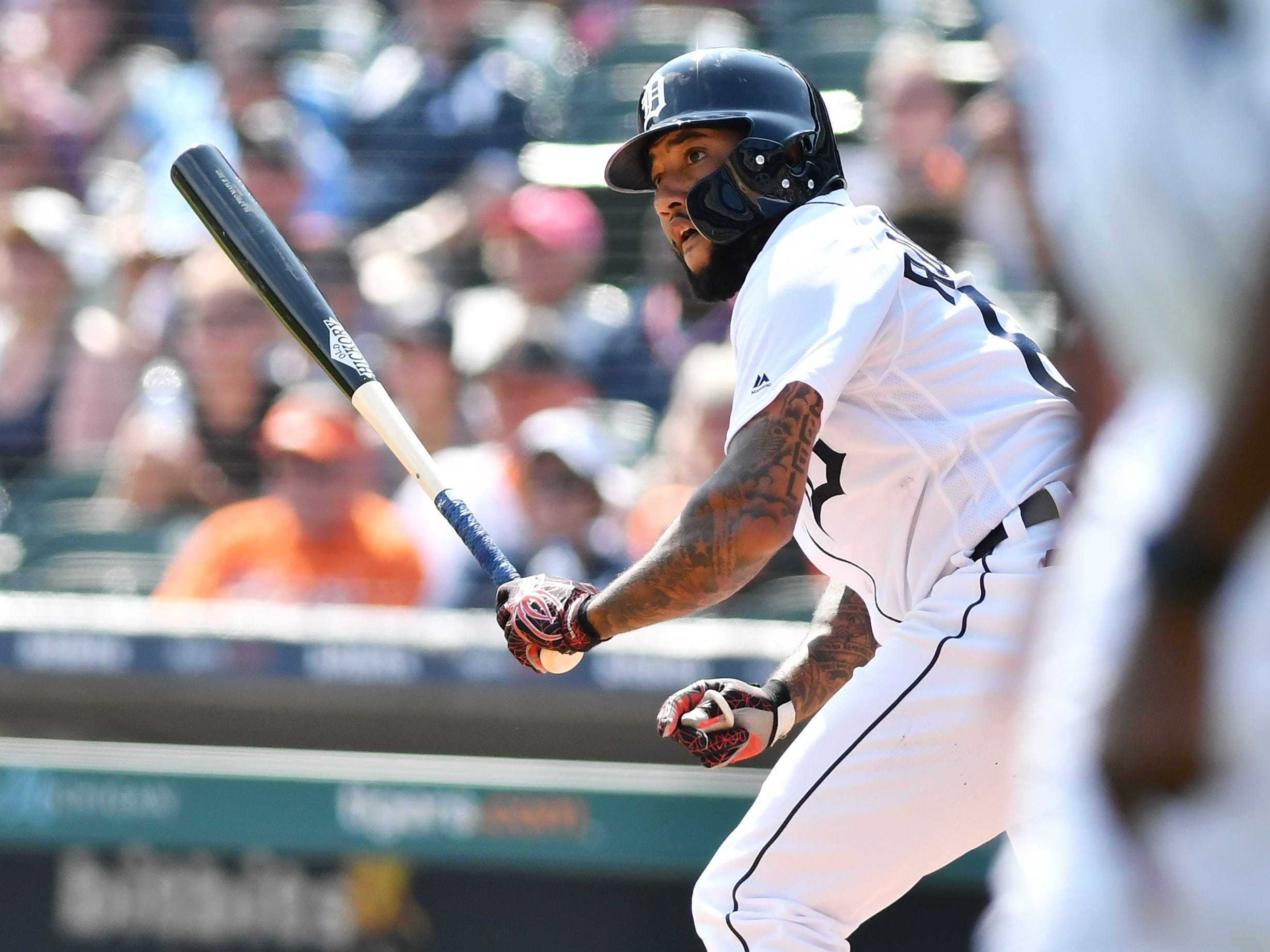 Tigers' Ronny Rodriguez watches his RBI double in the eighth inning.
