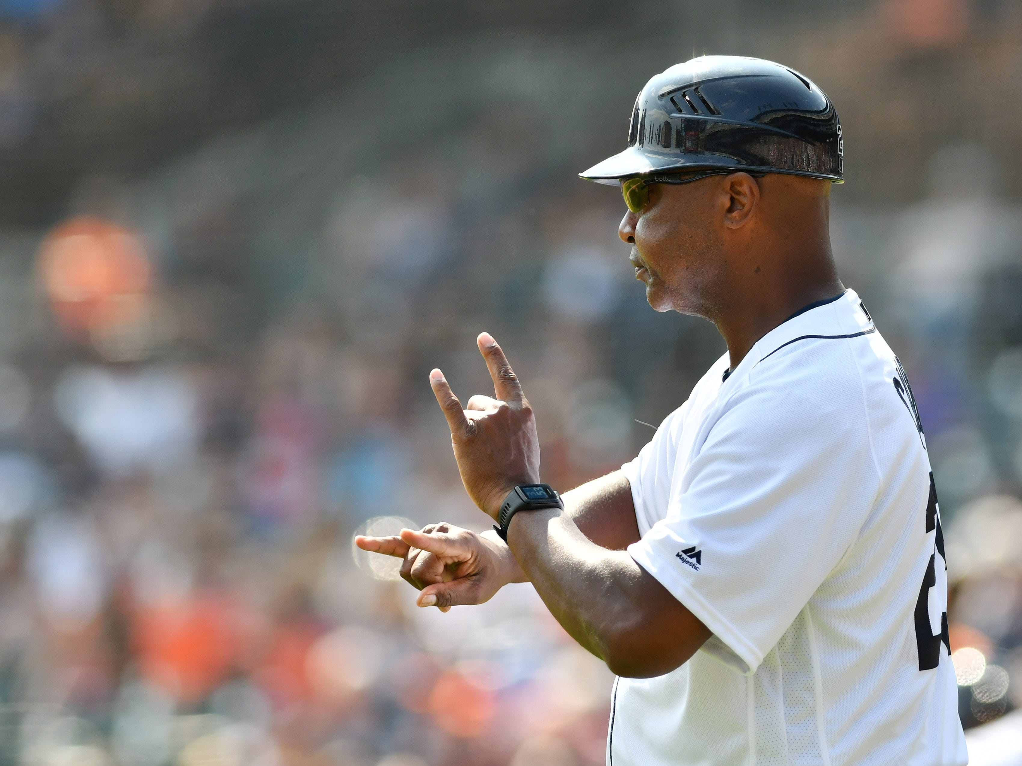 Tigers third base coach Dave Clark signals to Niko Goodrum in the eighth inning.