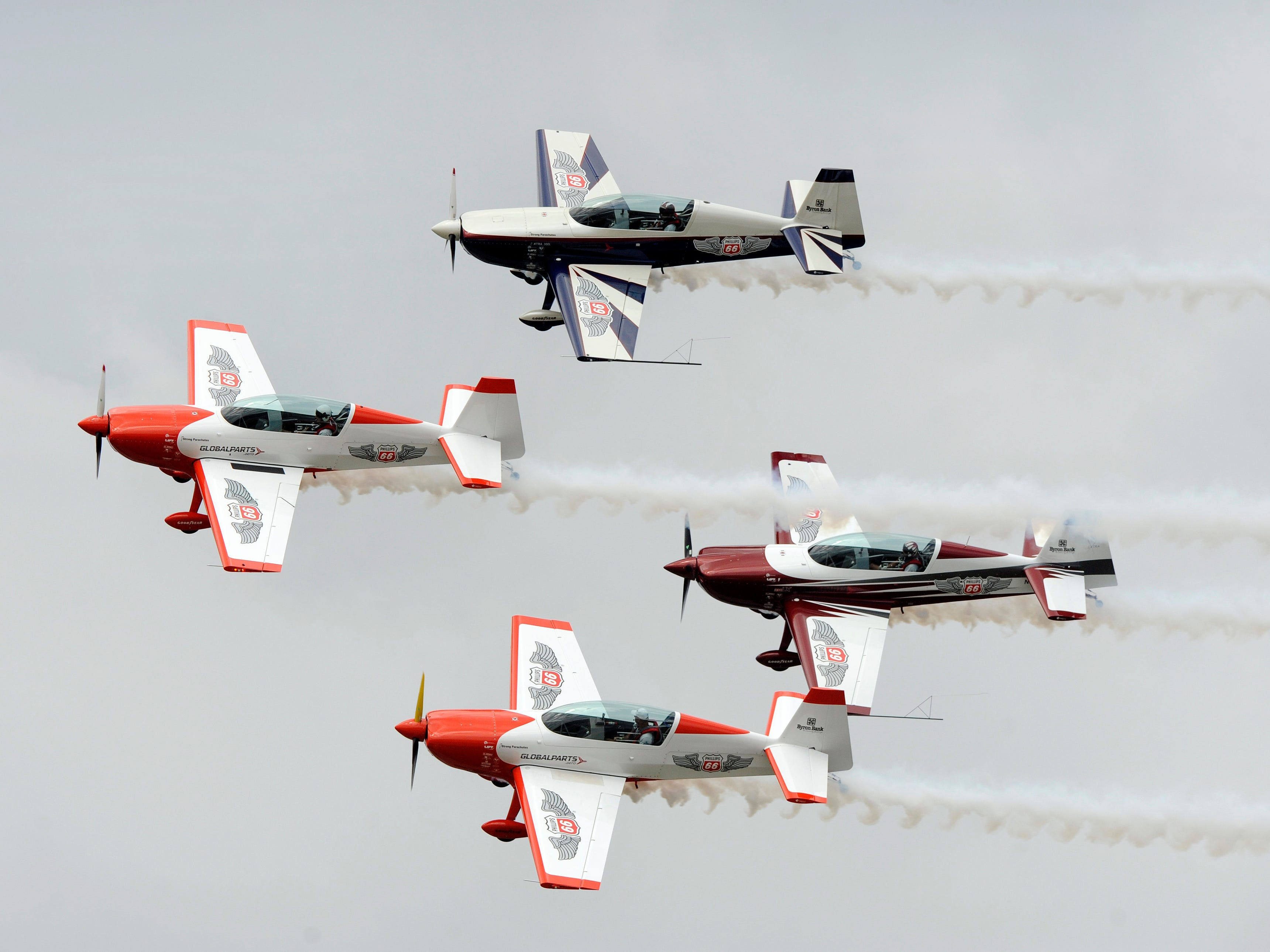 The Phillips 66 Aerostars fly in formation.