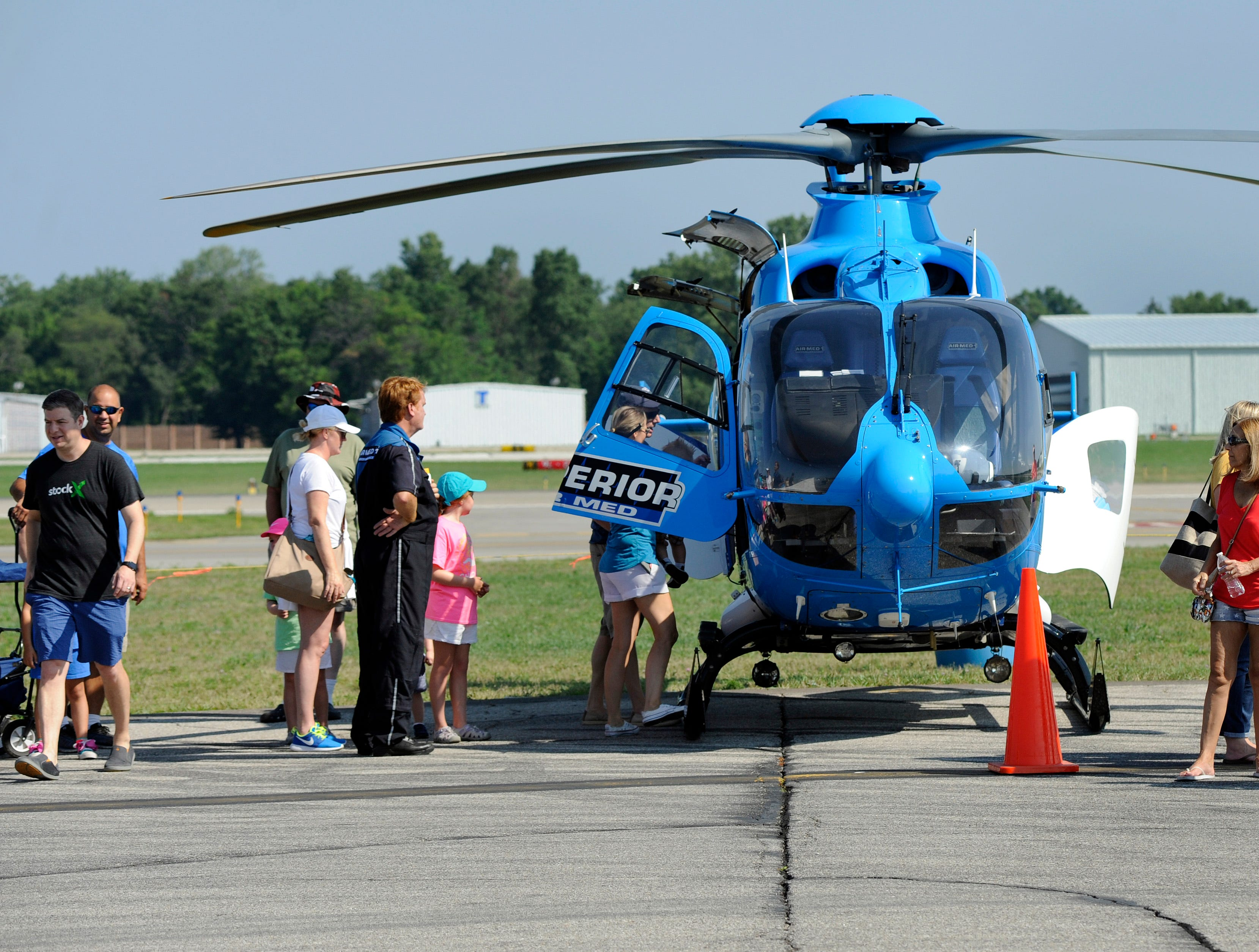 Visitors to the Air Show & Open House look over the Superior Air Med I helicopter, which is used by Henry Ford Hospital through Superior Ambulance Service.