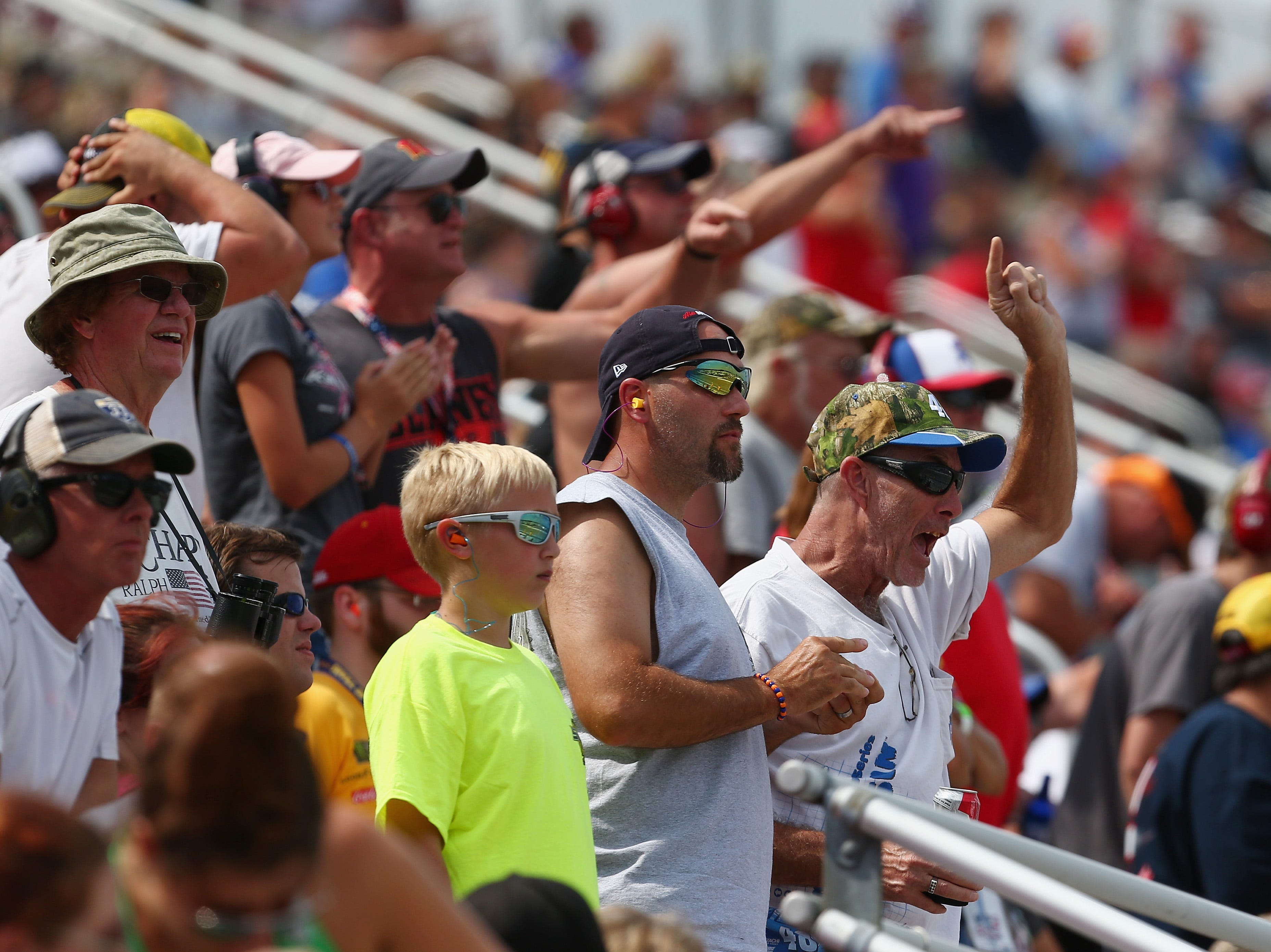 Fans cheer during the Monster Energy NASCAR Cup Series Consmers Energy 400 at Michigan International Speedway.
