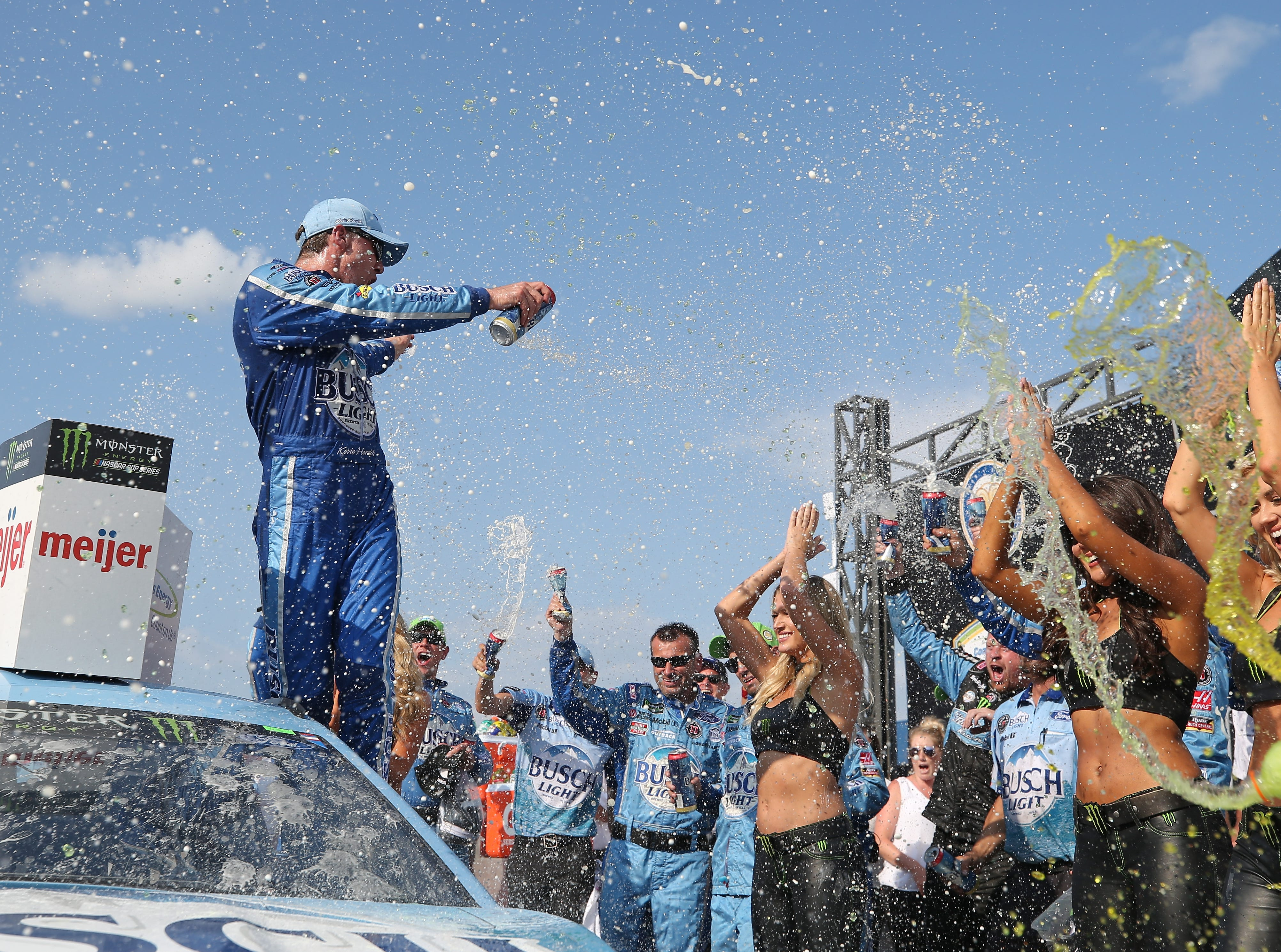 Kevin Harvick, driver of the #4 Busch Light/Mobil 1 Ford, celebrates in Victory Lane after winning the Monster Energy NASCAR Cup Series Consmers Energy 400 at Michigan International Speedway.