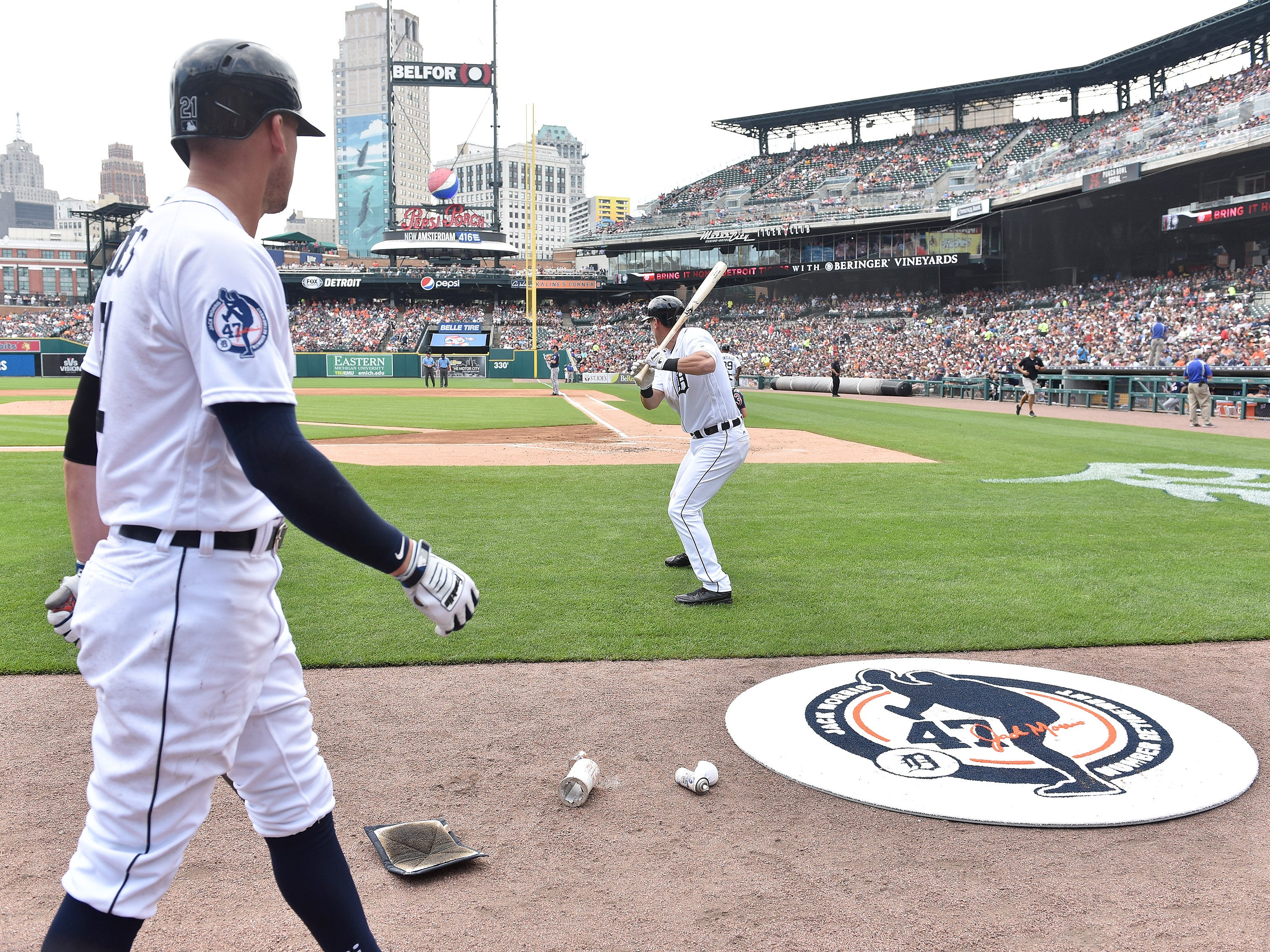 In the second inning, Tigers' JaCoby Jones, left, and Jim Adduci on deck next to the special edition of the on deck circle honoring Jack Morris.